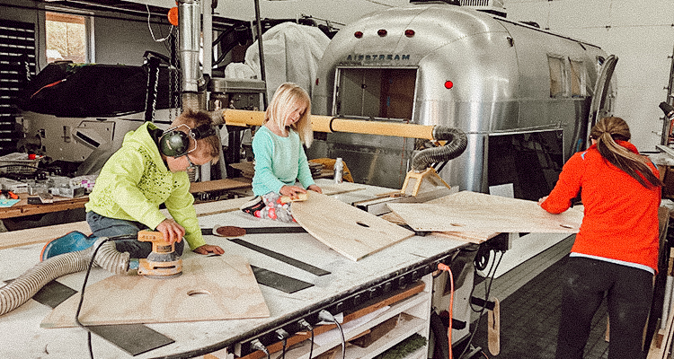 A mother, son and daughter getting creative while actively renovating their 1996 Airstream Overlander